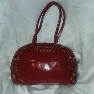 Red imitation leather purse